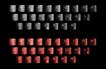 Keyboard letters isolated on black background, top view