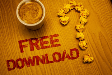 Text sign showing Free Download. Conceptual photo Files Downloading Without Any Charges Online Technology Words written Desk Coffee White mug crumbled paper notes question mark