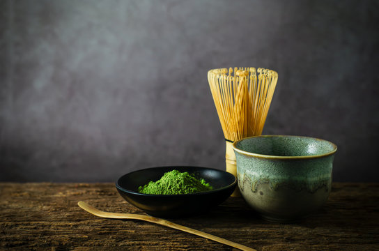 Japanese matcha green tea with bamboo whisk on wooden table