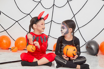 Two little girls in costumes for Halloween Wall mural