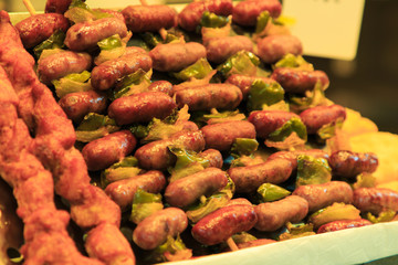 Skewers of Spanish sausages with green pepper in the Boqueria market
