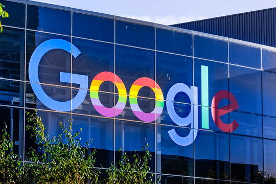 """June 8, 2019 Mountain View / CA / USA - Google logo displayed in the Company's campus in Silicon Valley; The """"double o's"""" are decorated in rainbow colors in honor of LGBTQ Rights Pride Month"""