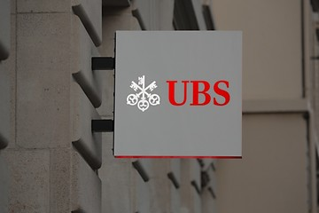 BASEL, SWITZERLAND - JULY 06, 2016: Sign of UBS bank on building facade. UBS is considered the world's largest manager of private wealth assets.