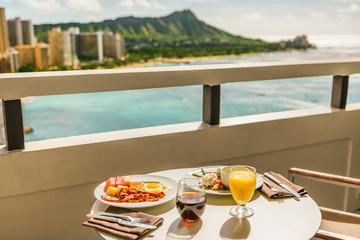 Hotel room breakfast on balcony view of Waikiki beach, Honolulu, Hawaii. Vacation travel morning...