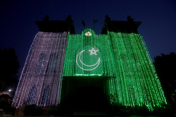 A general view of the Metropolitan building illuminated with national flag, ahead of Pakistan's Independence Day in Lahore