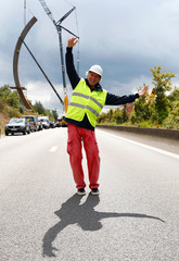French artist Bernar Venet poses near the Arc Majeur, a 60-meter arch designed by him and installed on the E411 highway in Lavaux-Sainte-Anne