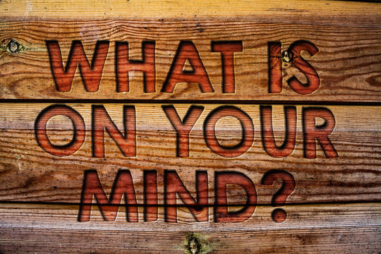 Handwriting text What Is On Your Mind Question. Concept meaning Open minded thinks of intellectual innovation Wooden background vintage wood board wild message ideas intentions thoughts