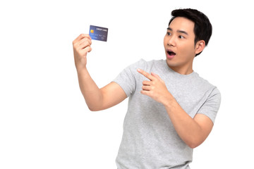 Asian man with wow face and showing credit card on hand isolated on white background