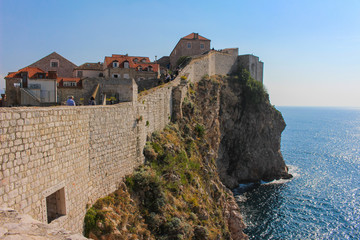 View of Dubrovnik and it's city wall surrounded by the  Adriatic Sea