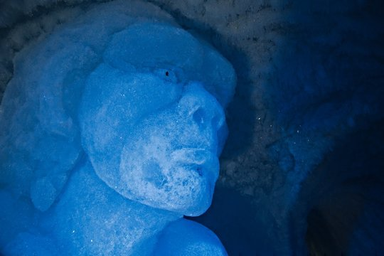 LES DEUX ALPES, FRANCE - FEBRUARY 14, 2014: Ice sculpture in the ice cave of the glacier of Les 2 Alpes ski resort