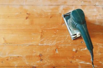 wooden floor sanding with flat sander tool Wall mural