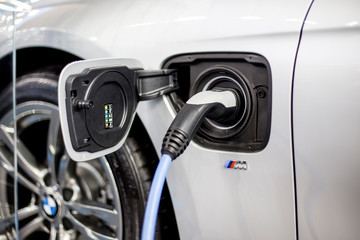 Recharging of hybrid BMW car. BMW ActiveHybrid technology unites a combustion engine and electric drive
