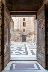 Opened door leading to the courtyard of Al-Sultan Al-Zahir Barquq mosque, Old Cairo, Egypt