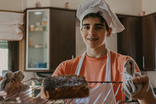 young chef with freshly made sweet or cake
