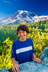 Fototapete - Young teenage boy laughing while standing in front of Mt. Rainier.