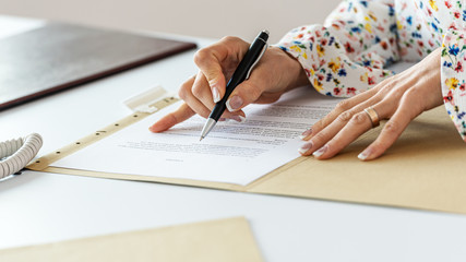 Businesswoman proofreading a contract