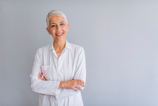 Senior female doctor. Woman doctor smiling and looking to the camera. Portrait of beautiful mature female doctor looking at camera. Beautiful female doctor. Medical concept