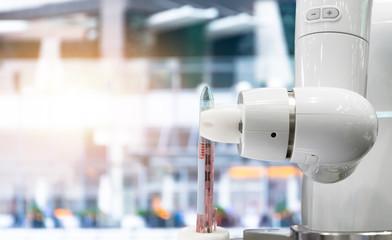 Robotics Trends cobot technology business concept. Automation collaborative robot technology robot arm for serve mass production pen with flare light effect.