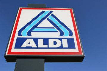 BERGNEUSTADT, GERMANY - October 30, 2016: Aldi sign (north division) against blue sky. Aldi is a leading global discount supermarket chain with almost 10,000 stores in 18 countries.