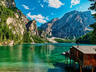 Amazing Panoramic view of Braies Lake with hut and boats in Dolomites mountains in summer Sudtirol, Italy