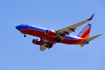 September 11, 2018 San Jose / CA / USA - Flying Southwest Airlines aircraft approaching Norman Y. Mineta San Jose International Airport and preparing for landing; blue sky background