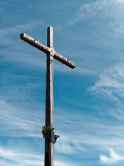 wooden cross against blue sky