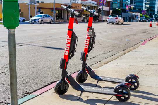 December 3, 2018 Los Angeles / CA / USA - Jump electric scooters parked on a sidewalk; JUMP is a dockless electric bicycle and scooters sharing system acquired by UBER; it operates in US and Germany