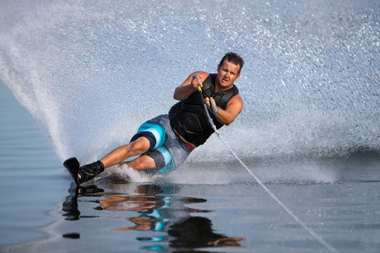 A slalom waterskier carving a turn.