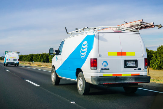 December 3, 2018 Los Angeles / CA / USA - AT&T service vans driving on the freeway; emblem displayed on the side