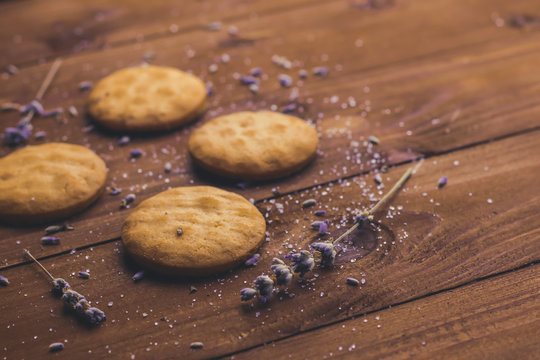 Composition with tasty lavender cookies on wooden table