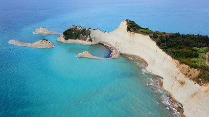 Tuinposter Kust Aerial drone bird's eye view photo of iconic white rock volcanic tropical islet with emerald clear water sea