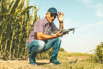 modern technological farmer as he prepares to fly the drone over his cultivated fields