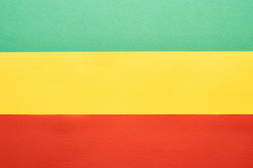 top view of colorful green, yellow and red Rastafarian flag