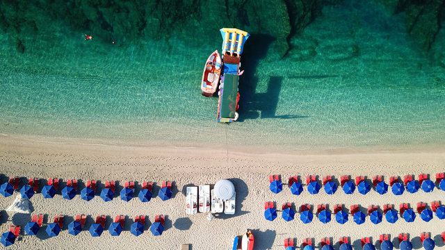 Aerial drone photo of natural beauty bay and sandy beach of Valtos with watersports facilities and emerald sea. Parga, Epirus