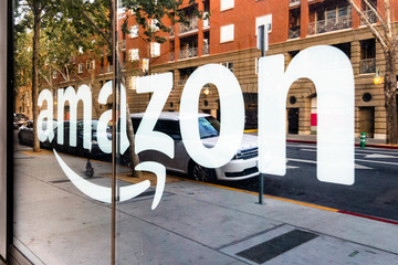 May 12, 2019 San Jose / CA / USA - Amazon sign on the window of the Amazon Hub Locker in the downtown area, Silicon Valley
