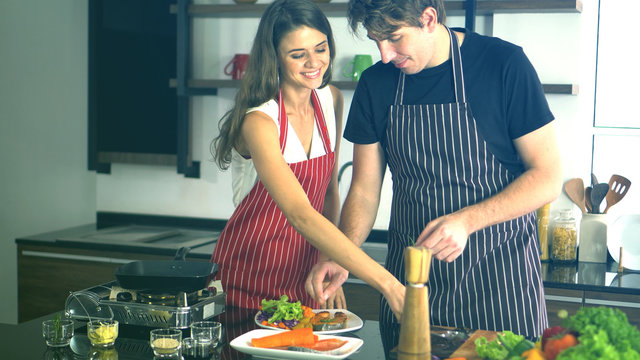 Cuacasian couple positive quality time cooking together