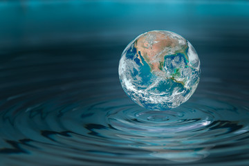 World dropping in a water drop ,concept for water pullation and conservative.Elements of this image furnished by NASA