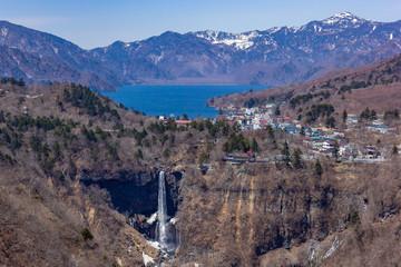 High angle view of lake Chuzenji, Kegon falls and mountain range at the Akechidaira observatory deck.