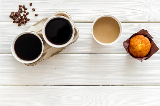 Coffee to go on white wooden background top view mockup