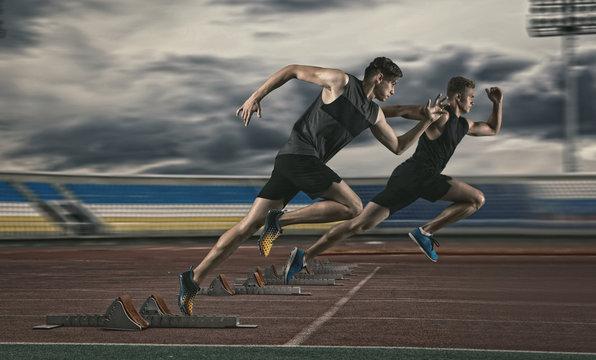 Two man sprinter leaving starting blocks