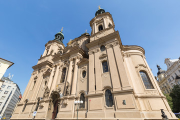 Front of the Church of Saint Nicholas in the Old Town (Stare Mesto) of Prague in Czech Republic, on a sunny day.