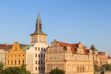 View of old buildings and a clock tower at the Old Town in Prague, Czech Republic, on a sunny day.