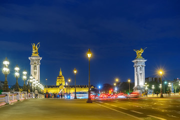 Paris France city skyline night at Seine River with Pont Alexandre III bridge