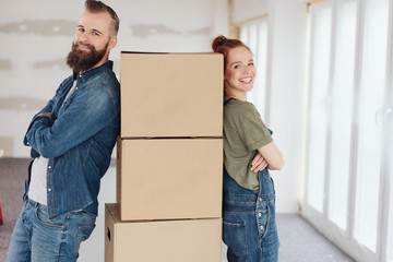 Proud pleased young couple moving into a new home