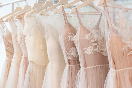wedding dresses hanging on racks