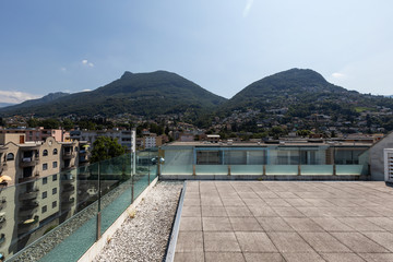Private terrace with city and mountain views