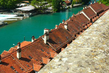 Old characteristic houses near the river Aare as seen from the platform near the cathedral in Bern, Switzerland, summer 2019