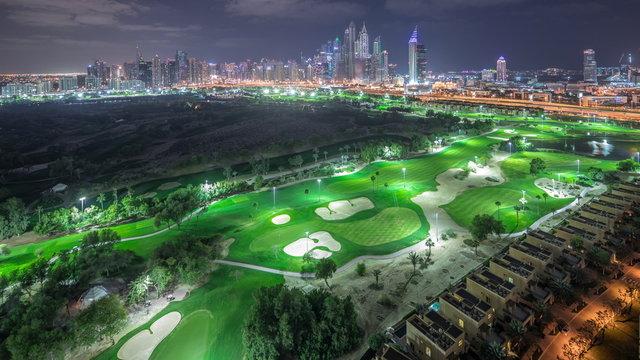 Dubai Marina skyscrapers and golf course night timelapse, Dubai, United Arab Emirates