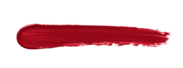 Lipstick smear smudge swatch isolated on white background. Creamy makeup texture. Red color cosmetic product brush stroke swipe sample