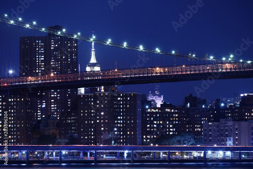 Fotobehang Tiers of bridges over the bay and night skyscrapers. New York. night photo. USA.